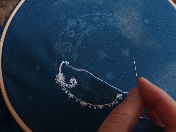 Work in progress photo of crescent moon embroidery