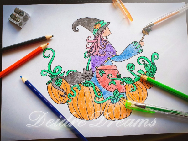 Witch in pumpkin patch coloring page colored in with pencils