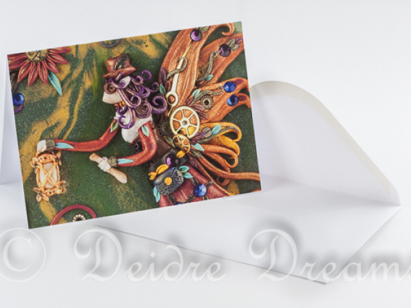 Photo of steampunk fairy greeting card and white envelope