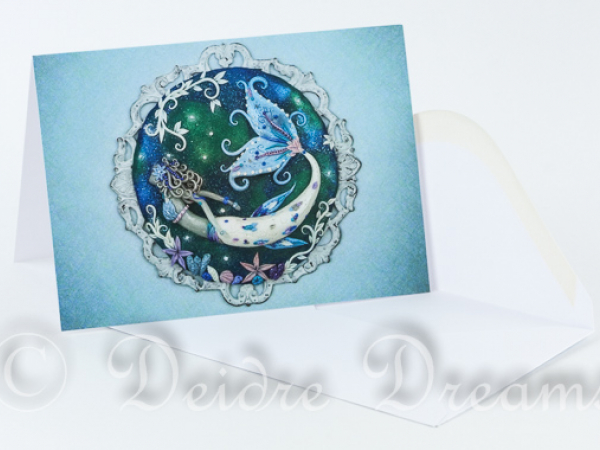 Overview of greeting card with white envelope