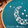 Side close up of crescent moon finished embroidery