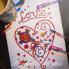 Love heart coloring page colored in with glitter gel pens