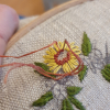 Photo of embroidering of a French knot stitch
